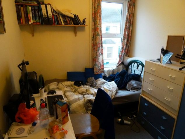 One of the tidier shots, this bed is tangled with wires, with an assorted food and plastic bags on the desk